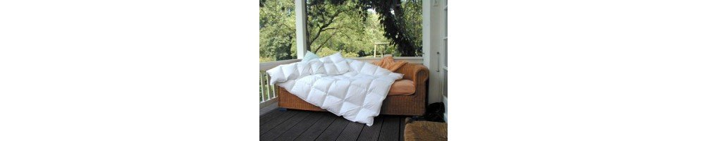 Купить пуховое одеяло  с бесплатной доставкой по России, быстро и надежно.